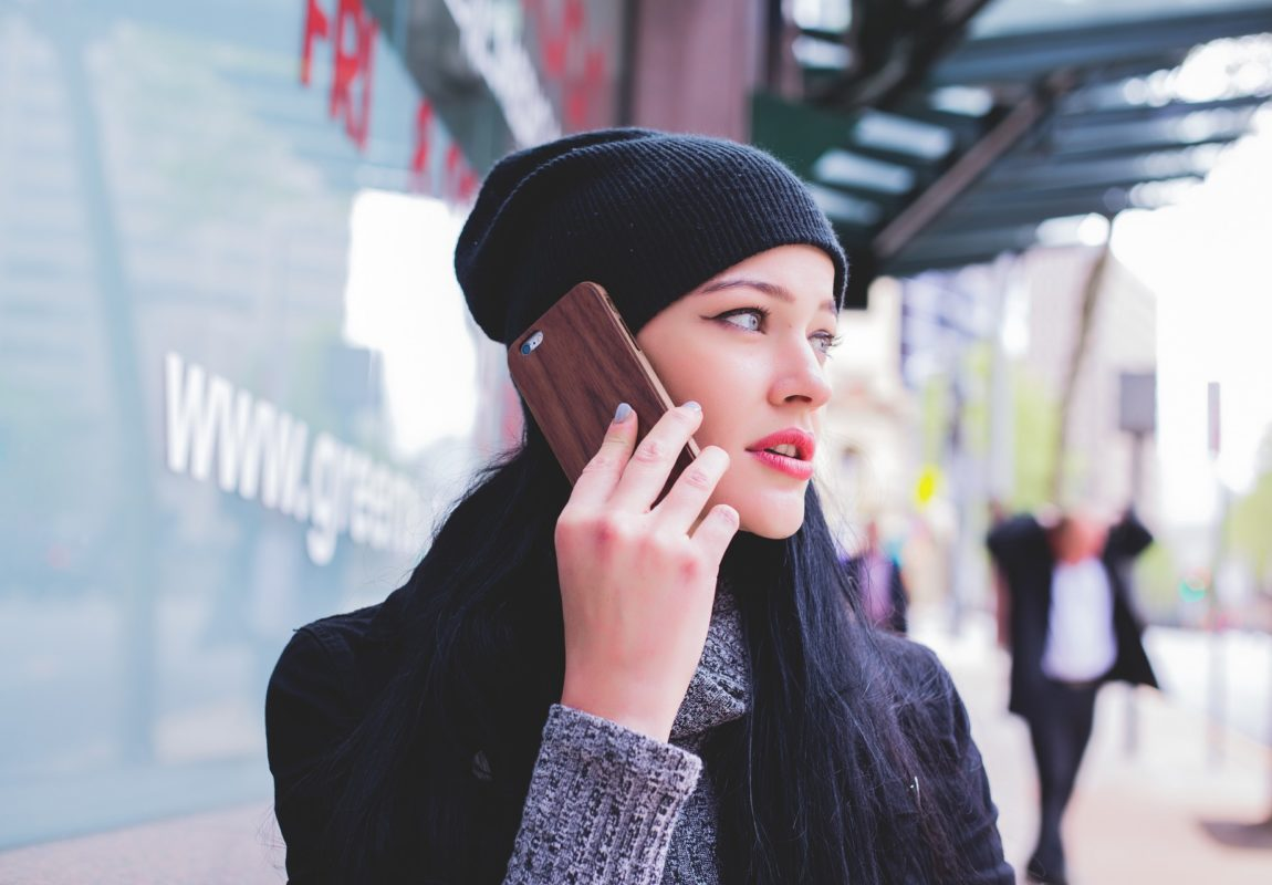 girl on phone near doctor | HealthCare.com