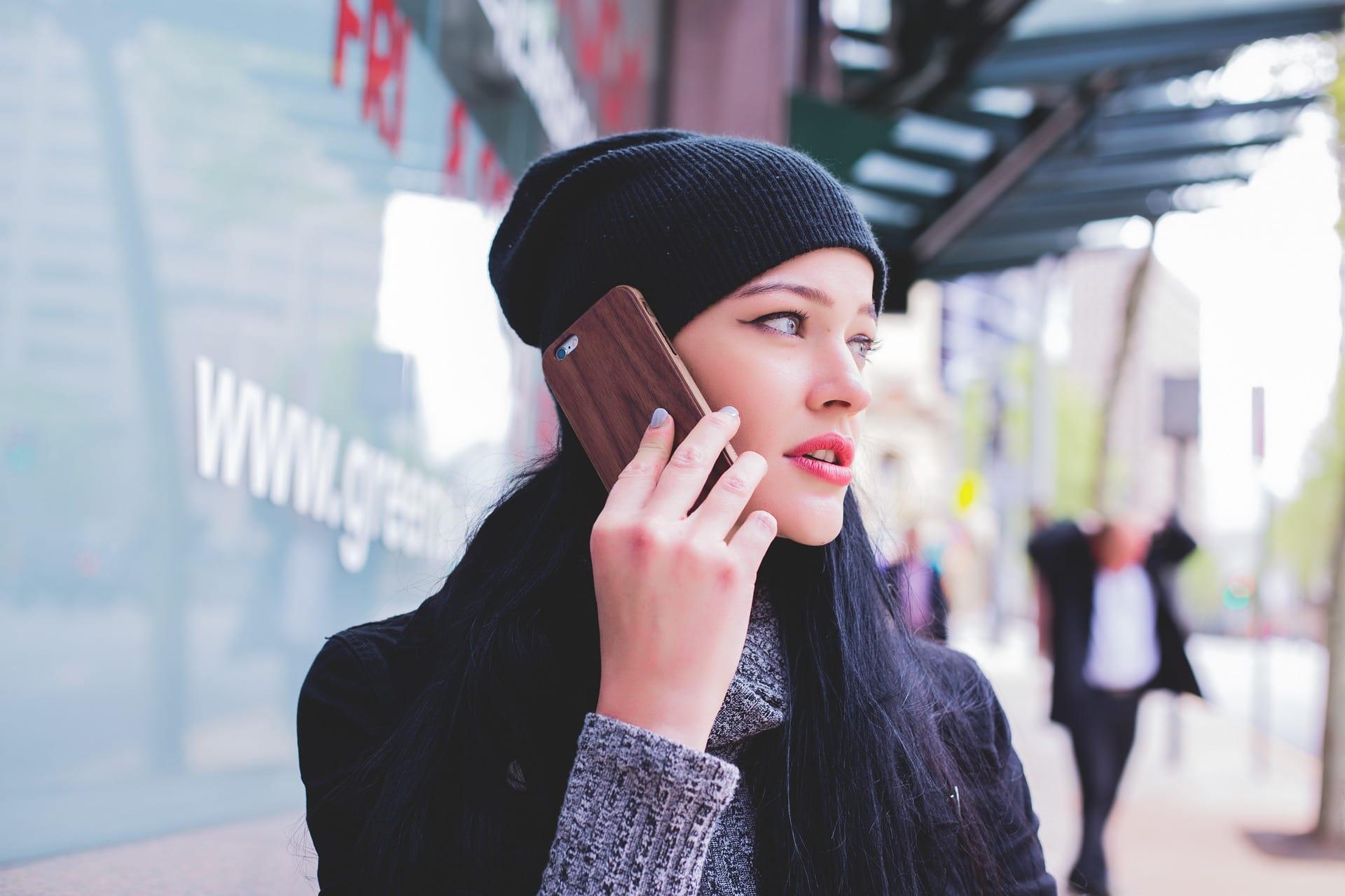 girl on phone near doctor   HealthCare.com