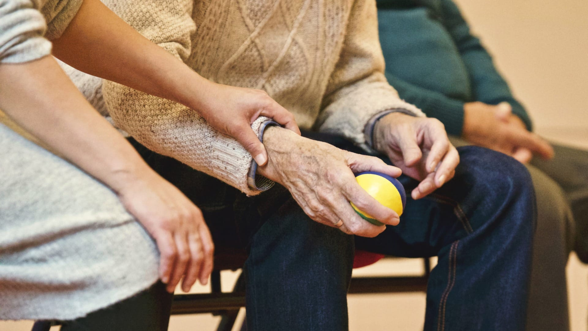senior grabbing ball with nurse | HealthCare.com