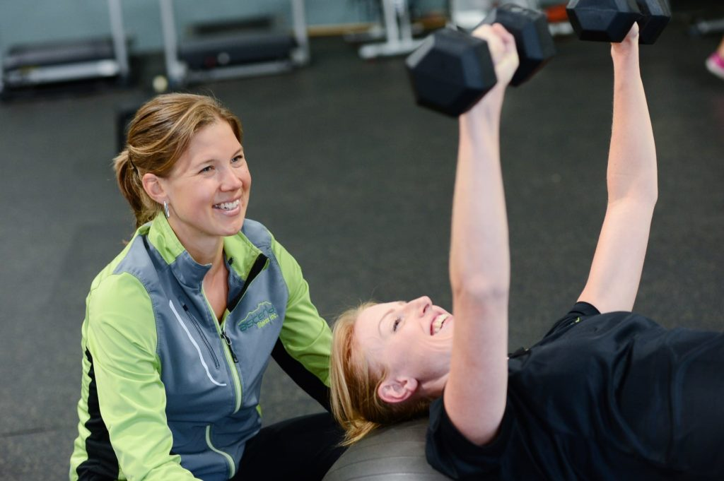 woman at gym   gym membership health insurance benefit