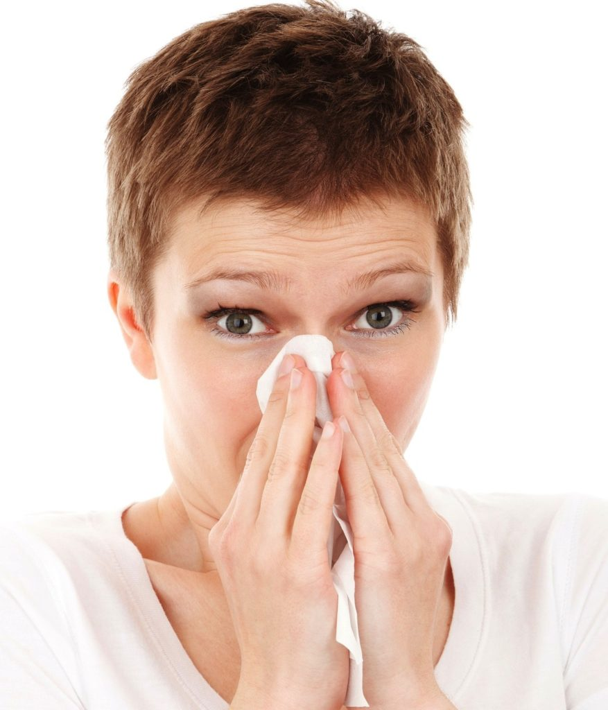 sneezing woman | allergist | 10 checkups