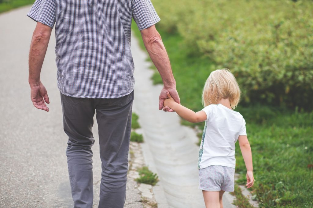 pre-Medicare health insurance   older adult holding small child